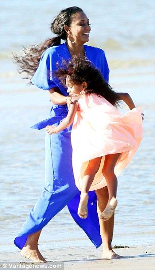 Mel B throws gleeful daughter Madison in the air on fun family day out