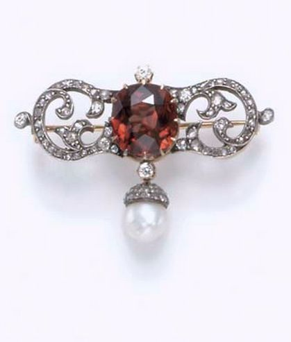 AN ANTIQUE BROWN ZIRCON, PEARL AND DIAMOND BROOCH Designed as an old European and rose-cut diamond scrolled bar, centering upon a cushion-cut brownish orange zircon, accented by old mine-cut diamonds, suspending a pearl drop, measuring approximately 8.00 mm, with a rose-cut diamond cap, mounted in silver-topped gold, circa 1870.: