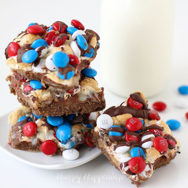 You don't need a campfire to enjoy the great taste of s'mores. These S'mores Magic Bars have layers of chocolate, graham, and toasted marshmallows and can be baked in an oven. They are perfect for the 4th of July. Recipe from HungryHappenings.com