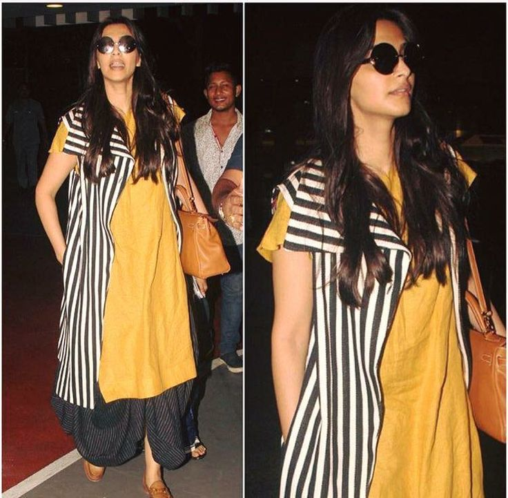 Sonam Kapoor one of our favourite in our striped high collar jacket ,  mustard long box top and pinstriped skirt mixes and matches her separates  perfectly.