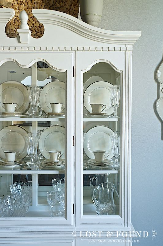 white china cabinet against grey wall