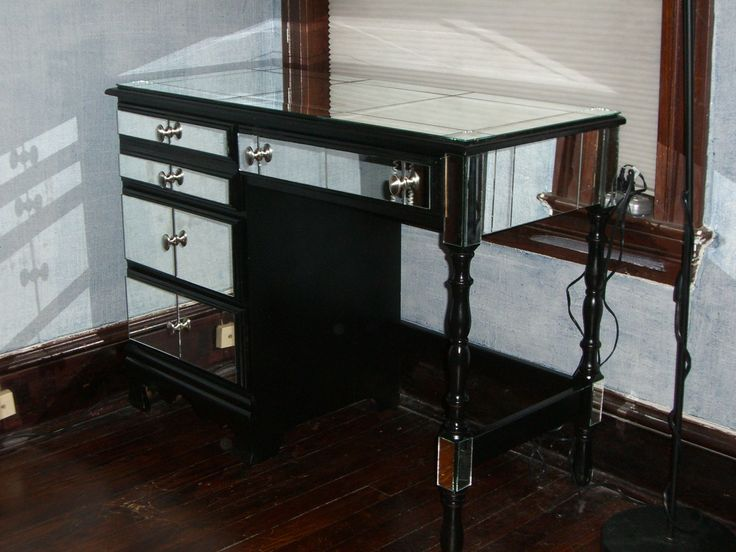 """Jule inherited an old piece of furniture which she deftly upgraded into a mirrored vanity. Guess mirrors and vanity do go well together. Jule says, """"I was given an old student desk which my parents bought at a garage sale before I was born. I never liked it, but it was really functional as a [&hellip"""