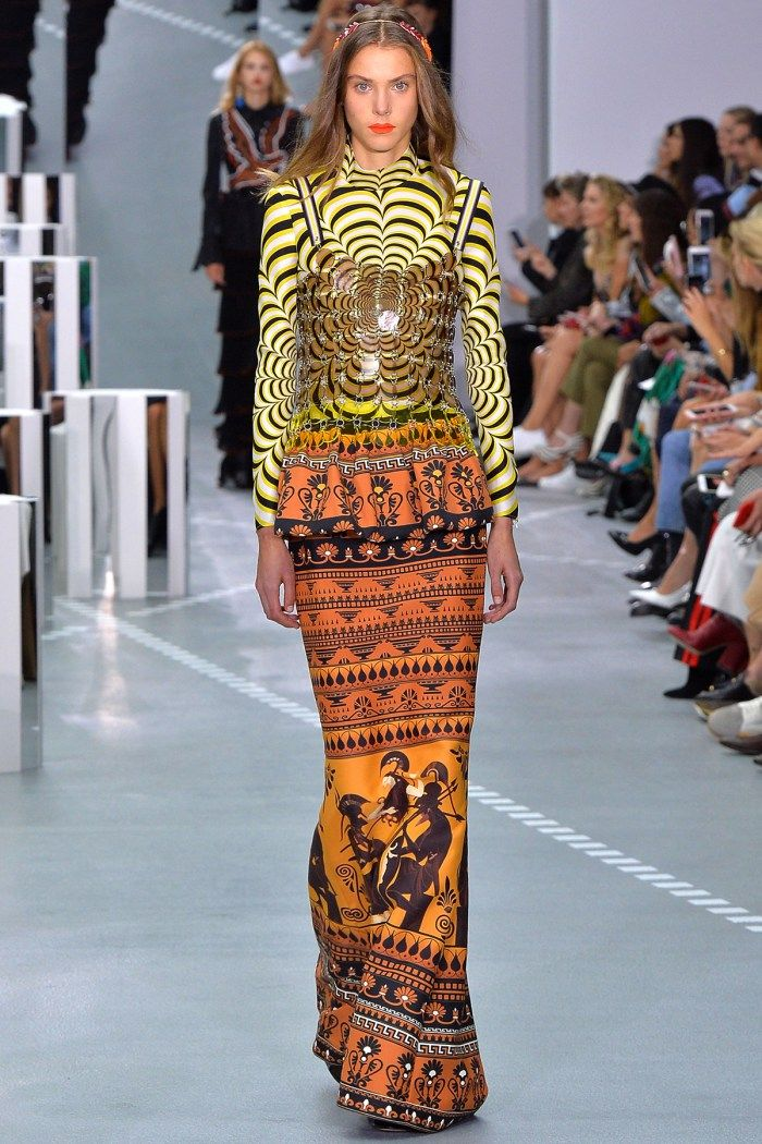 Mary Katrantzou | Lenti top – Sculpt top scalop yellow – Hera skirt dewel | Mary Katrantzou combines the ancient with the hyper-modern, fusing classicism with futurism and sixties art. Ancient artefacts are warped through op-art designs, mapped across the topography of the…