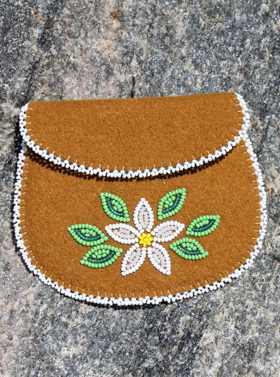 "This coin purse is beautiful. Crafted by Dene artisans in Northwest Territories, it is made of stroud - European cloth traded in the Arctic for centuries. It features unique beadwork and you'll find lots of uses for it. Measures 4.5"" wide x 4"" high (12 cm x 10 cm)."