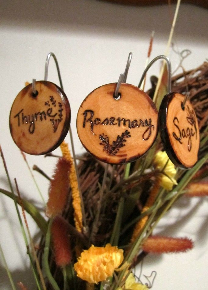 Garden markers from slices of wood, wire, and wood burning. Clever.