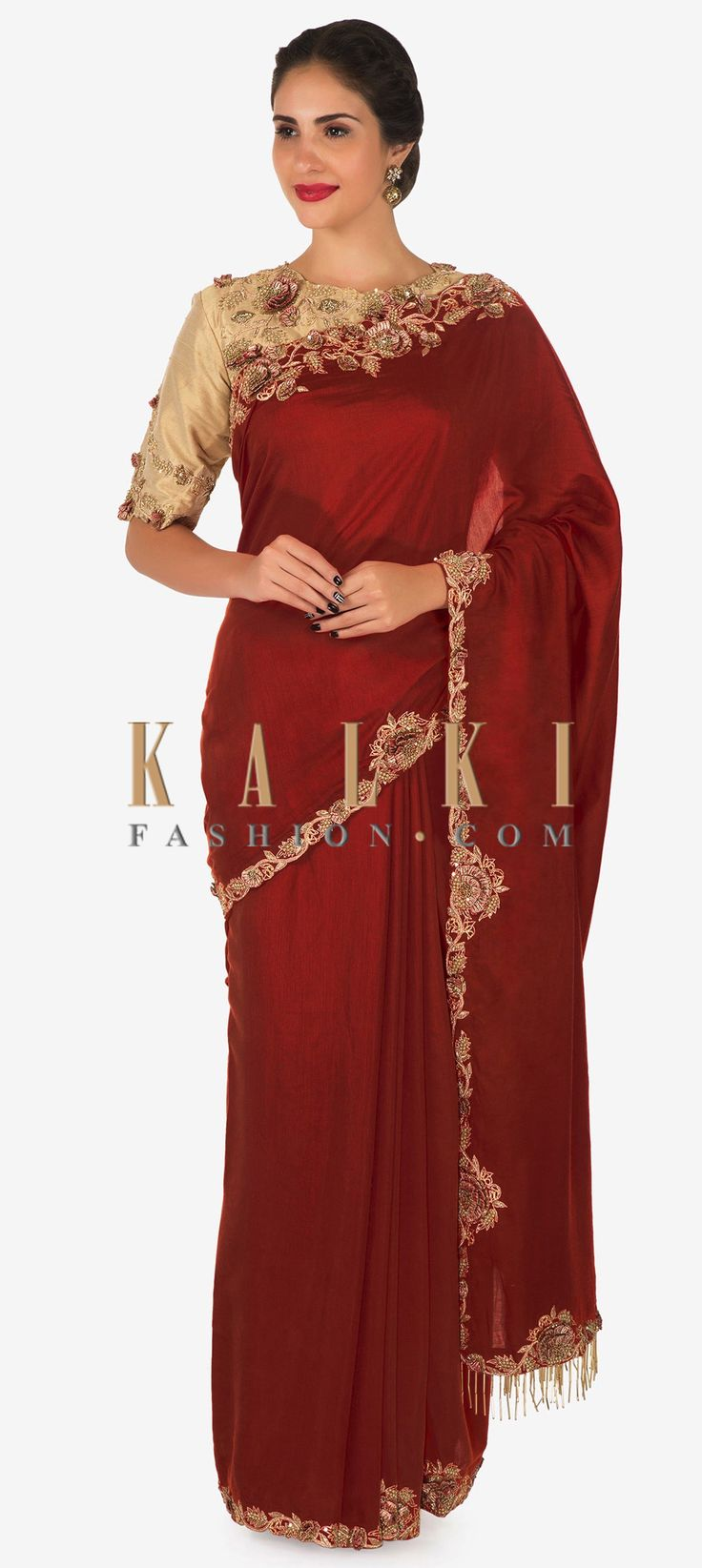 Buy Online from the link below. We ship worldwide (Free Shipping over US$100)  Click Anywhere to Tag Orange saree with ready blouse in beige designed with zari and zardosi embroidery work only on Kalki Orange saree is featured in cotton silk fabric. The saree is beautifully decorated with zardosi embroidered borders highlighted with zari and sequin beautification. The saree flaunts 3D flowers at the borders and the pallav has attached tassels at the hem. Matched with a ready stitched blouse…