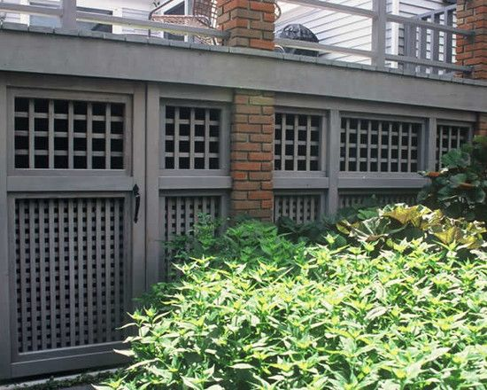 Great idea for underdeck storage with unobtrusive door built into the lattice - this is usually a very unattractive area but here it looks very pulled together