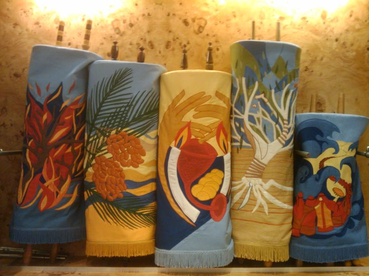 These Torah mantles, designed by Alison Shearman, were the first out of seven designed for the North Shore Temple Emanuel. The Torah has been compared to fire, honey, light, wine, a tree and water. These have been encapsulated in each of the designs. The two following designs compared the Torah to a fig tree and also to song.