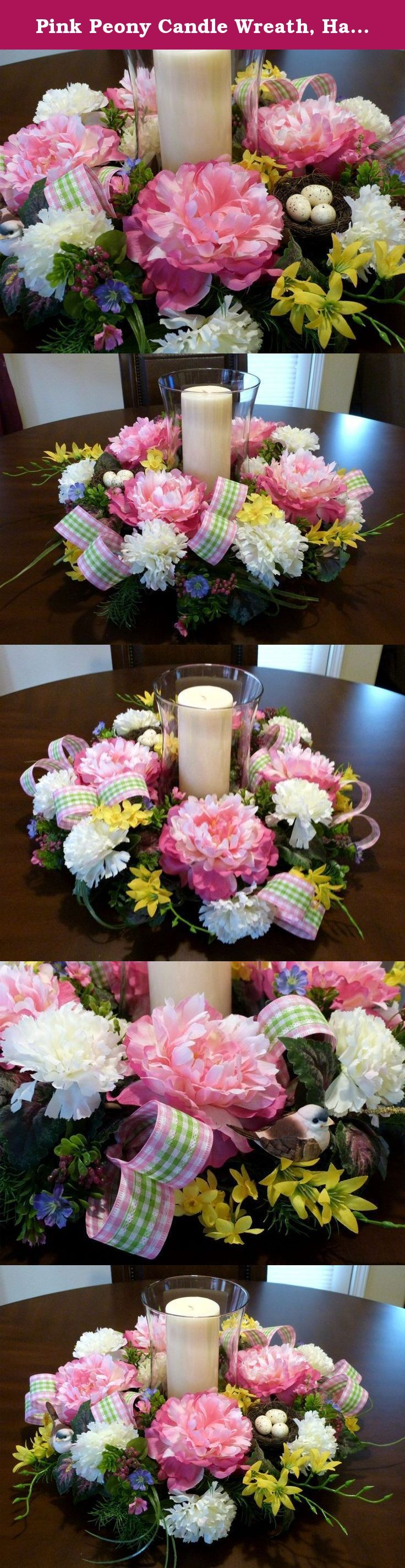 Pink Peony Candle Wreath, Handmade Table Wreath with Peonies, Candle Wreath With Peonies. This spring candle centerpiece was made on a 12 inch grapevine base with large pink/cream peonies, cream carnations, yellow narciscus, yellow freesia and more. There is an assortment of greenery including coleus and asparagus fern, pretty green/pink checkered ribbon and cute little bird and bird's nest. This centerpiece will add beauty to your home decor and would be perfect for a everyday…