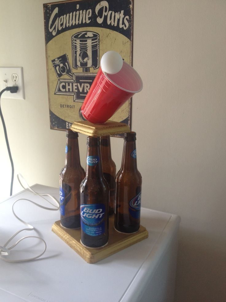 Beer pong/ beer Olympics trophy. Made of actual beer bottles,wooden pieces painted gold (found at any craft store) a red solo cup and a ping pong ball. HOT GLUE IS CRUCIAL.