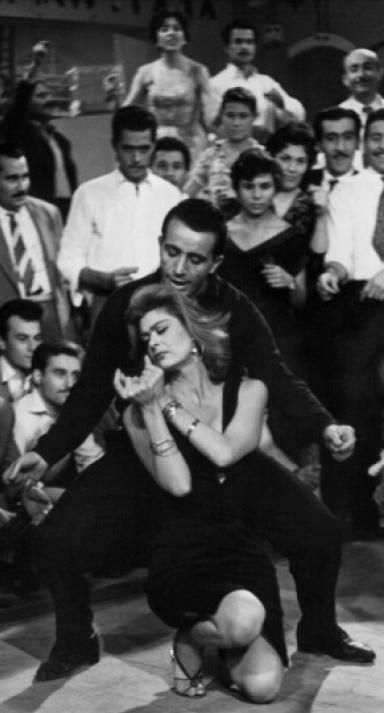 Titos Vandis & Melina Mercouri in 'Never on Sunday', 1960, written & directed by Jules Dassin.