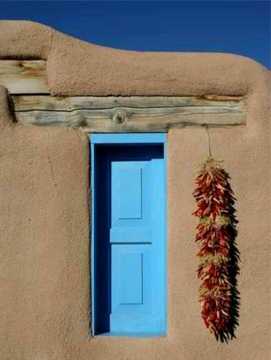 Southwestern adobe home with chillies