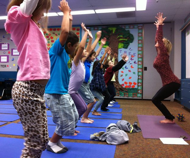 Third-graders at Olivenhain Pioneer Elementary School in Encinitas, Calif., perform the mountain pose with instructor Kristen McCloskey last month.