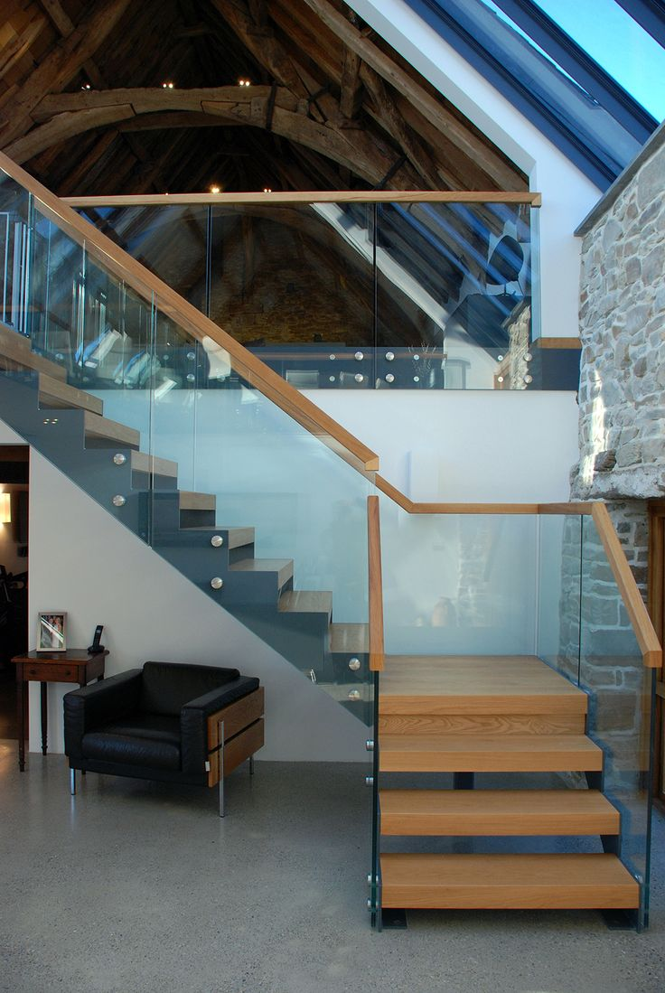 Medieval Grade II* listed Barn Conversion, Cornwall, bespoke staircase, wood and glass, glazed balustrade.