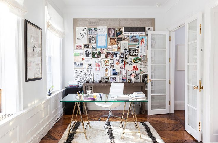 a glass desk, moroccan rug, and white walls in the officeAlison Cayne's West Village Townhouse