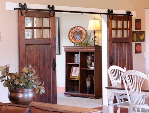 If I ever get to remodel anything in this house (I have ALWAYS wanted these)....sliding barn doors will be my first request....second will be a claw foot tub.