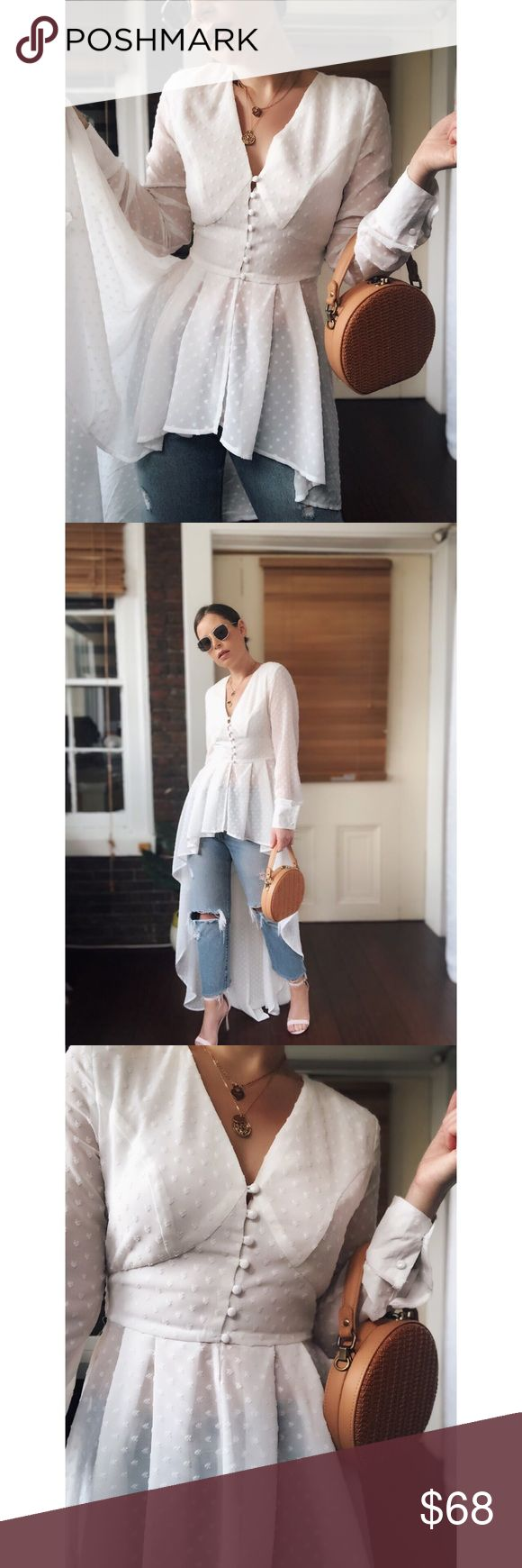 🆕1st Date White High Low Duster Top New Boutique Item. The 1st Date Top features a high low silhouette, sheer sleeve detailing, button down front, …