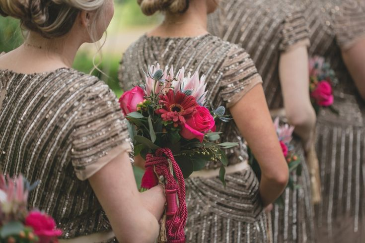 Glitz and Glam Wedding Ideas - art deco style bridesmaid dresses and pink bouquets
