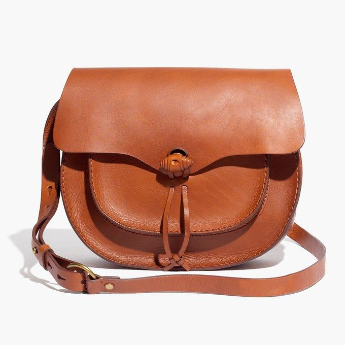 Crossbody bags are a spring fashion trend we love - start shopping our favorites now (like this brown leather style from Madewell).