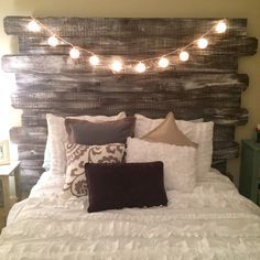 Whitewashed rustic headboard made from fenceposts