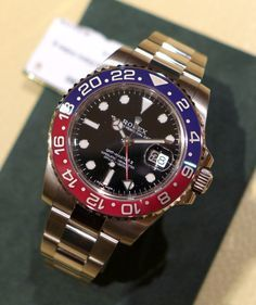 "Baselworld 2014: New Rolex GMT-Master II with ""Pepsi"" Bezel. Traditionalists rejoice: the GMT Master with a red and blue ""Pepsi"" bezel – the watch that graced the wrists of the Concorde test pilots – is back, and it's better than ever."