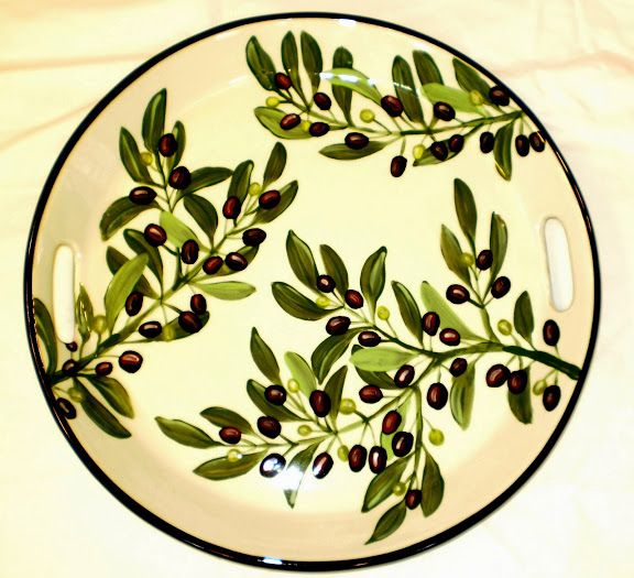 Olive ceramic tray, a current pattern painted by Geoff Graham in Vallejo, California at Cinnabar Ceramics.  You can google the Cinnabar Ceramics Website if you want to know more.
