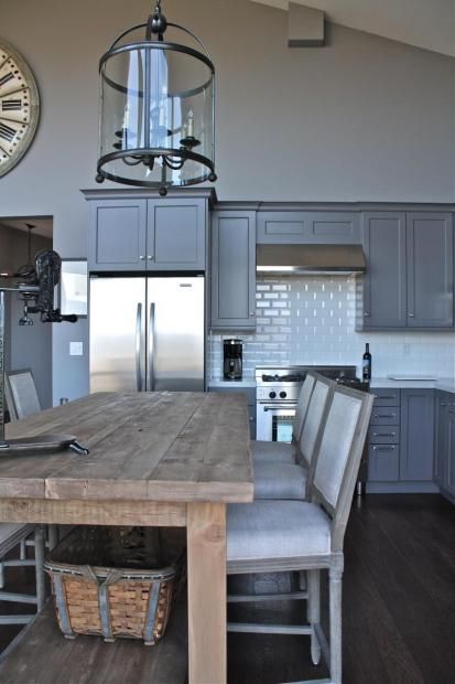 Modern farmhouse style - This is what I've always envisioned for my kitchen...an open space with a big old farmhouse table. I don't need the kitchen to be this fancy, but I'm drooling over the table!
