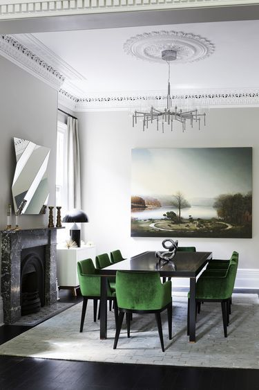 Antique, modern mix dining, with yummy emerald upholstered velvet chairs.