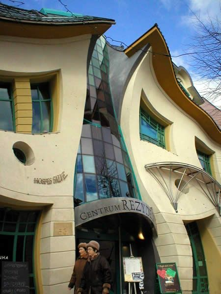 Polish architect of the Crooked House, Szotynscy Zaleski, was inspired by the fairytale illustrations of Jan Marcin Szancer and the drawings of the Swedish artist and Sopot resident Per Dahlberg. The most photographed building in Poland, the 4,000 square meter house is located in Rezydent shopping center in Sopot, Poland.