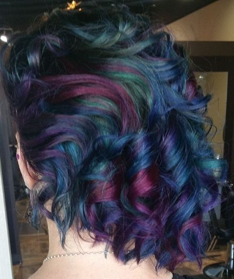 These short curls show off all of the gorgeous oilslick colors.