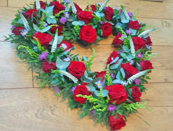 Red rose funeral wreath by Mia's flowers