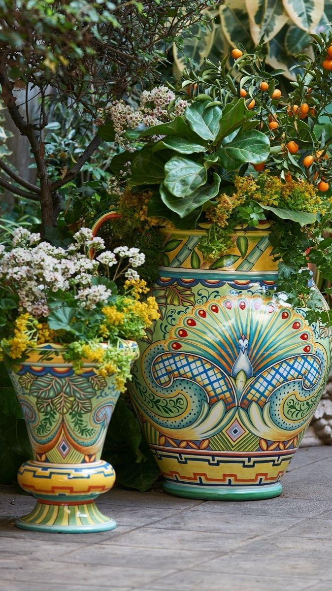 The brilliant plumage of the peacock fans across vivid botanicals for dramatic visual appeal on our Sol Painted Planter.
