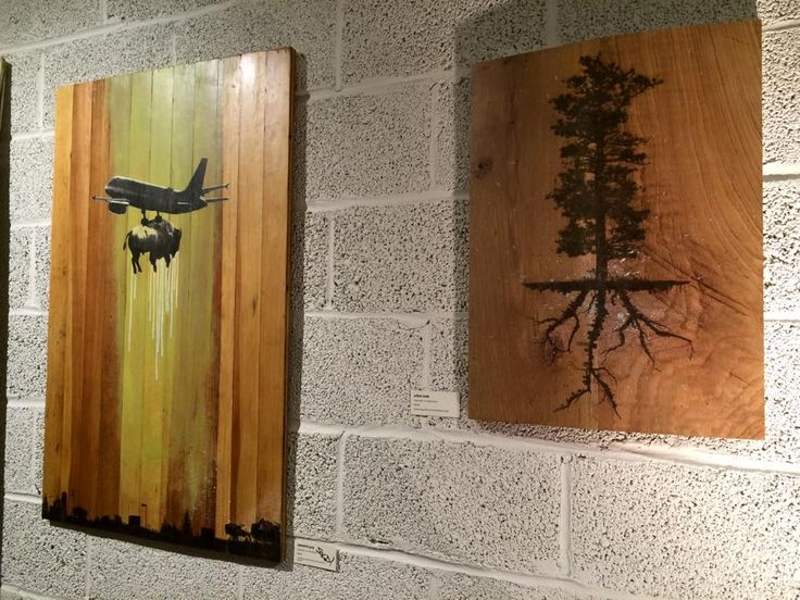industrial prey (L)  - mixed media on reclaimed 100 year old pine floor boards urban roots (R) - mixed media on vintage walnut floor sample.