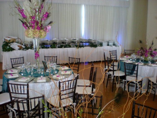 Ronald Shane Center - Miami Beach. Mahogany Chiavari Chairs, Silver square charger plates, Teal runners, buffet style, orchids and hydrangeas centerpieces. Catered by www.americaters.com