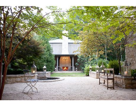 A cozy gravel garden. Designed by Ryan Gainey. housebeautiful.com #outdoor_fireplace #outdoor_living_room #landscape