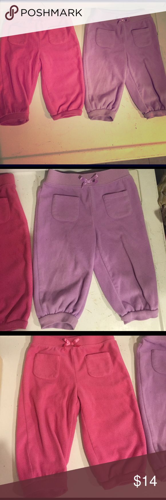 2 pack fleece pants 1 pair of pink fleece pants, 1 pair of lavender fleece pants. Comfy, good condition. jumping beans Bottoms Sweatpants & Joggers