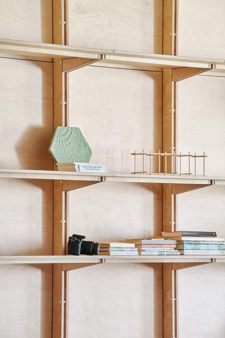 custom shelving system barcelona warehouse transformed into flexible co working space for architects and designers