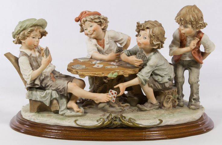 Giuseppe Armani 'The Cheaters' from Gulliver's World Figurine Having four boy figures playing cards, the maker's mark at front and an 'N' mark at back Height: 9.50 inches, Width: 16.00 inches, Depth: 9.00 inches Category: Figurines > Armani Shipping Status: Due to size, weight, value or shipping complexity, this item must be shipped via a 3rd Party and the shipping cost may be high. We recommend contacting multiple shipping vendors for a quote as the cost may vary greatly. Our clients have…