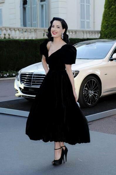 Dita von Teese black dress and heels