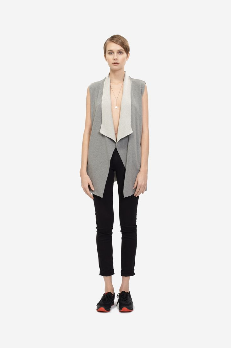 COTTON VEST Shorthaired model wearing a grey cotton vest with black sneakers. Design: Lucie Kutálková / LEEDA