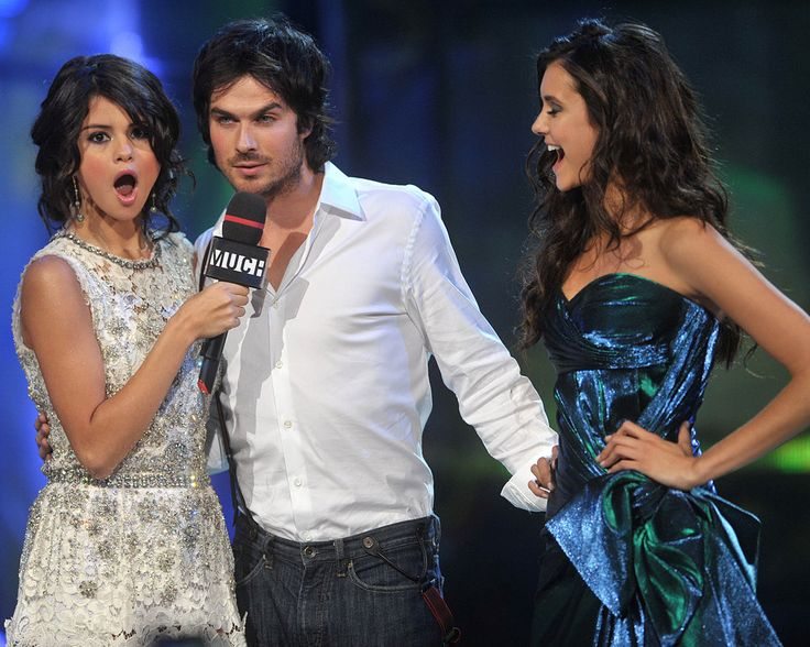 Happy Birthday, Nina Dobrev — See Her 24 Most Sassy and Sexy Shots!: Ian Somerhalder found himself in a sticky situation at the 2011 MuchMusic Video Awards in Toronto, where he was positioned between pretty ladies Selena Gomez and his real-life love, Nina Dobrev.    31      10