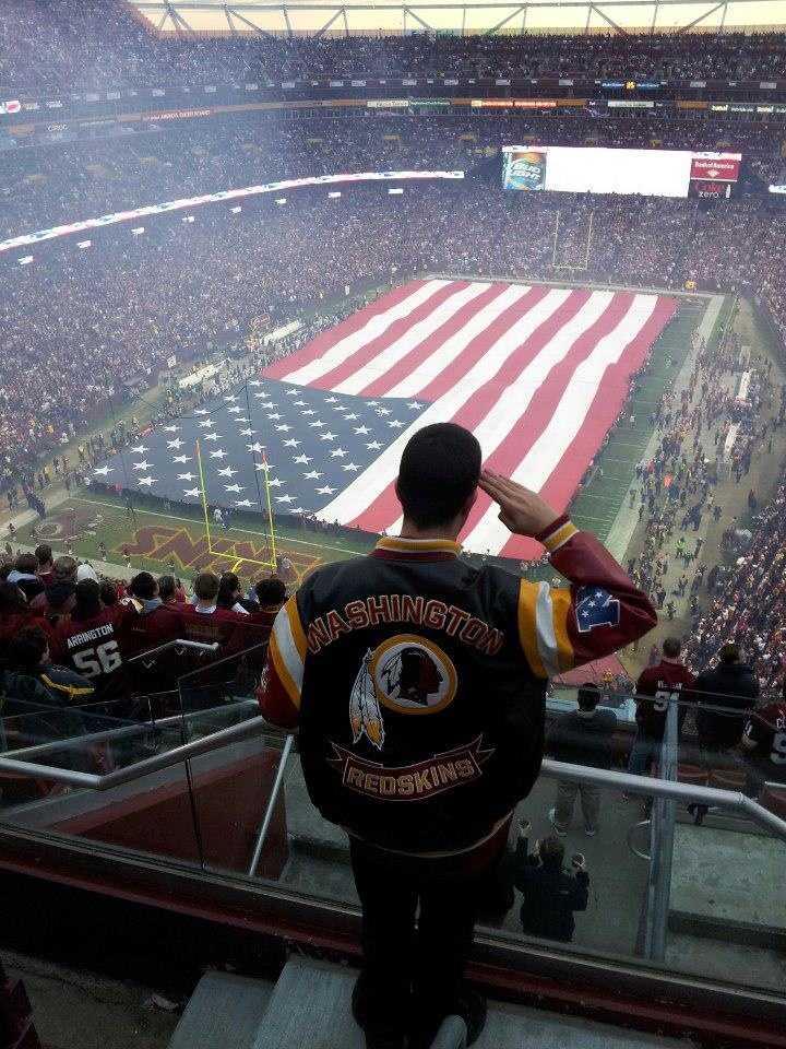 Photo of a service member saluting the American flag before the #Redskins vs. Seahawks NFC Wild Card Playoffs. Thanks to Sr. Vice Commander Jacobo Flores of VFW Post 8469 for sending this photo in.