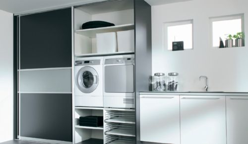 Love the laundry room..clean and lots of storage space
