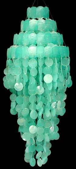 For capiz and sea glass lovers, this is the perfect wind chime. Superb green color.