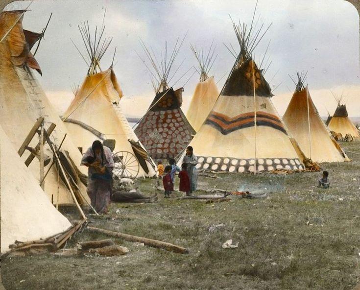 """Painted tipis of the headmen"". Blackfeet. Montana. Early 1900s. Glass lantern slide by Walter McClintock."