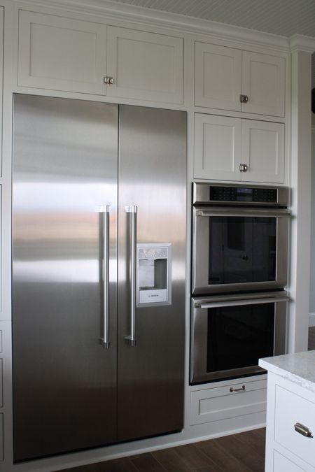 Column refrigerators and freezers are separate units that don't have to be installed together. You can have your freezer in one area, and fridge in another). Columns are really nice because they are installed flush with the cabinetry and don't have the vent on the top. They provide a really clean look.  I want this fridg and double ovens in kitchen someday.
