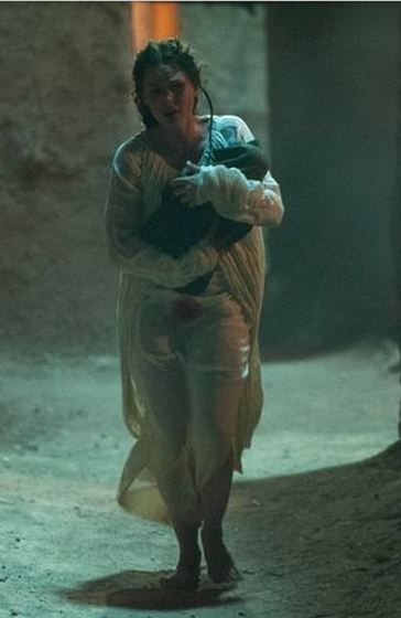 Midwife steals away with one of Rowan's twins to protect the child.