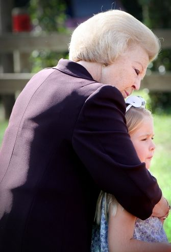 A hug from Oma, Koningin Beatrix, for Prinses Amalia who will be the next queen after her father, Prins Willem-Alexander, the first king since his great-greatgrandfather, Willem III.  Alex will be Willem IV.