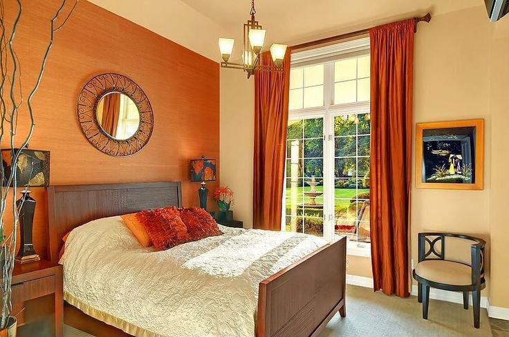 This Master bedroom tied in the accent wall colour with the curtains and throw pillow on the bed.