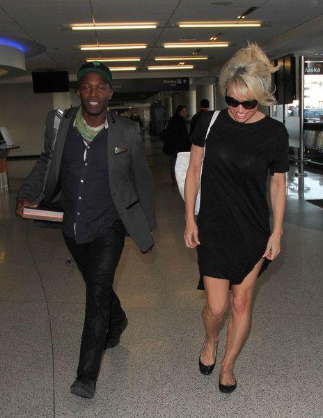 Pamela Anderson Photos - Pamela Anderson Is Seen at LAX - Zimbio